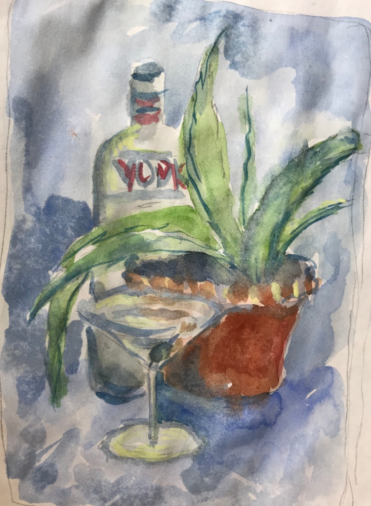 Bottle of vodka, aloe plant and martini glass
