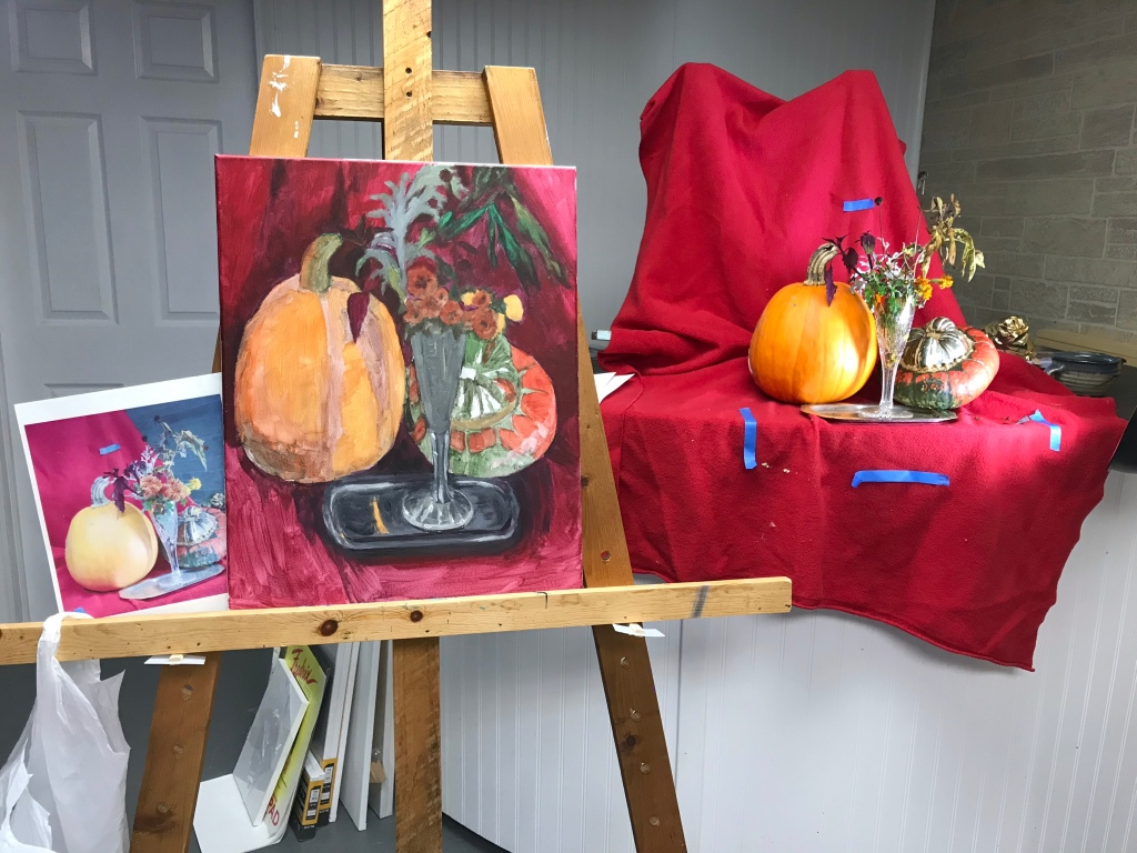 Underpainting of a still life of pumpkins and flowers
