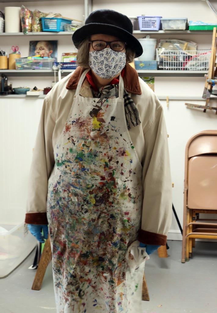Artist masked for pandemic